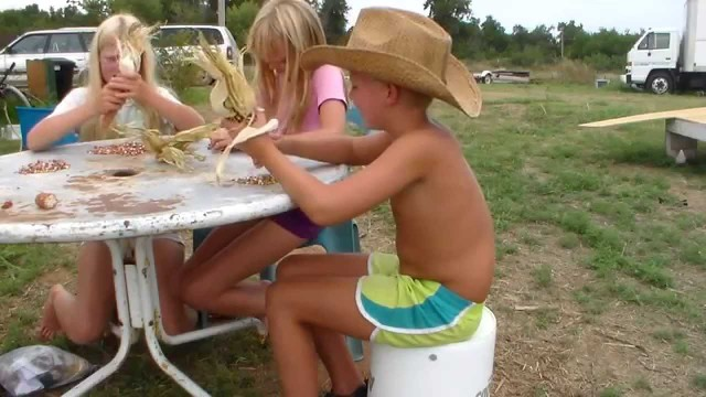 Kids Learning How To Shell Corn By Hand | Homestead Kids