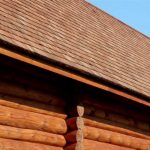 297 Brown colored log house with tar oiled cedar wooden shingle roof