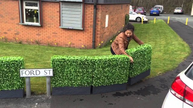 Bespoke artificial hedge building services floral hedge planters