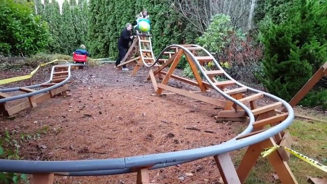 Dad builds awesome rollercoaster ride for kids in the garden!