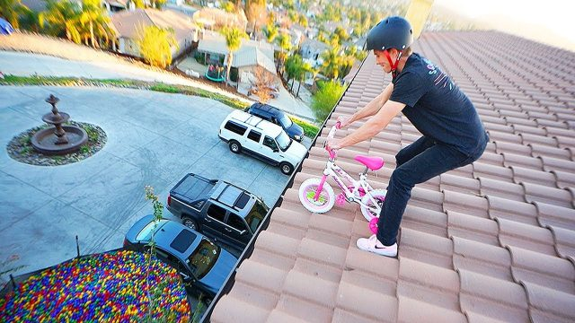 BARBIE TRICYCLE JUMPED OFF 30FT ROOF #intoballpit