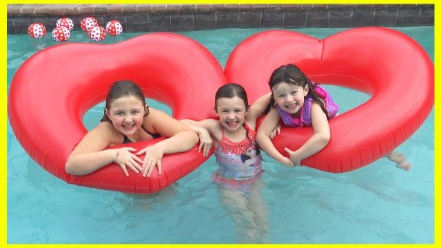Fun at the Swimming Pool | Video for Kids Playing in Water with Giant Valentines Day Floaty