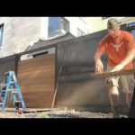 Aplocalypse proof fence – steel tubing and ipe wood built around steel planter boxes