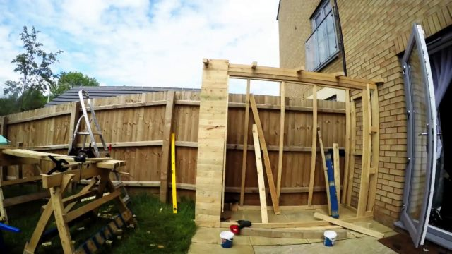 Pallet bike shed with a green roof