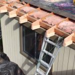 Brown roofing- Roof extended and vented soffit installed