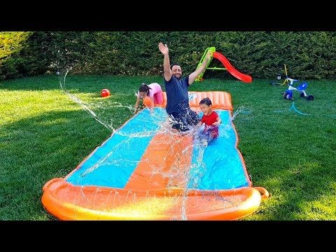 inflatable water slide in the garden, funny kids video