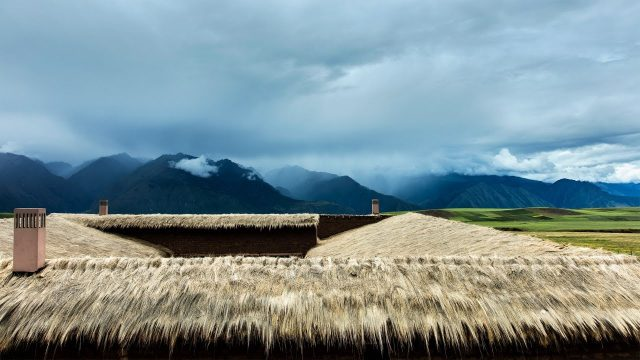 Fraying grass roof tops Mil Centro restaurant in Peru's historical Sacred Valley