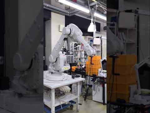 robot arm simulation watering the vertical farm