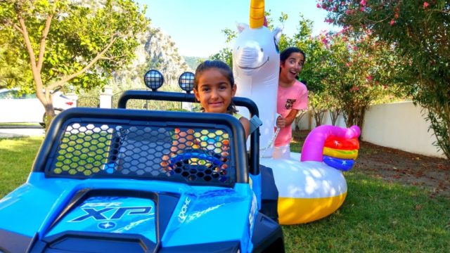 Esma and Asya play with inflatable Unicorn  garden  play fun kids video