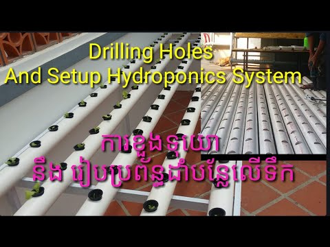 Drilling holes and installing hydroponics system vegetable garden on the rooftop