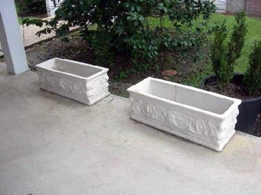 """concrete planters   <p />"""" width=""""375″ height=""""281″ longdesc=""""/arredo-giardino/fioriere/fioriera.asp""""/>They integrate perfectly even in the most modern buildings, even if they are very reminiscent of the houses of the 60s, the concrete planters.  Distinguished by the square style, they are widely used especially in condominium houses, thanks also to the provision of a suitable water drainage system.</p> <p>Unlike wood, concrete is particularly porous and makes it possible for excess water to evaporate, due to rain or prolonged watering.  Secondly, the cement is also very fragile, so even a small bump would be enough to cause injuries, which could make the planter unusable.A further defect, despite the fact that in recent years the manufacturers have indulged in the use of decorations and friezes, remains the weight of the concrete planters and their unwieldiness, so once placed, forget to move them, especially if filled with plants and soil, the undertaking would be almost impossible to achieve !!!   </p> <p>  <img loading="""