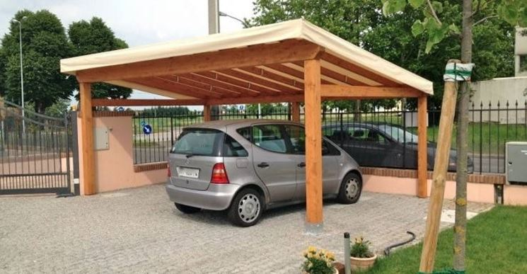 An example of a carport with a tarpaulin as a cover