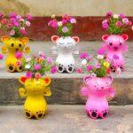Diy garden creative, recycling plastic bottles into cat flower pots for small gardens | Purslane